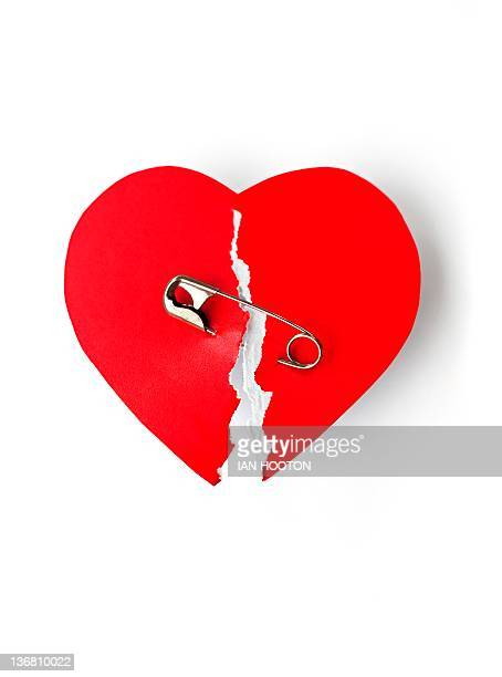 Mending a broken heart, conceptual image