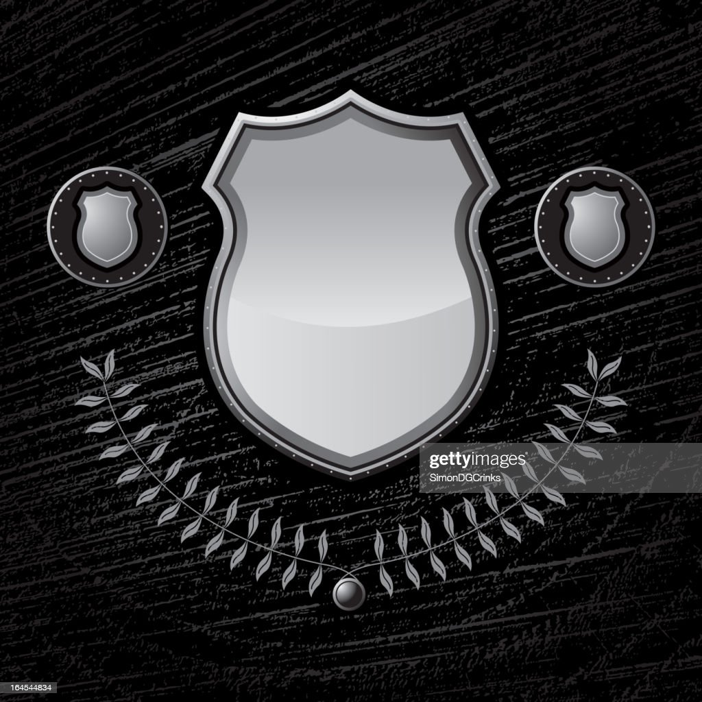 Metal Shield on layered wood texture background