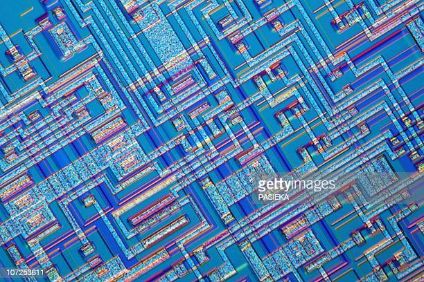 microchip, light micrograph - computer part stock illustrations
