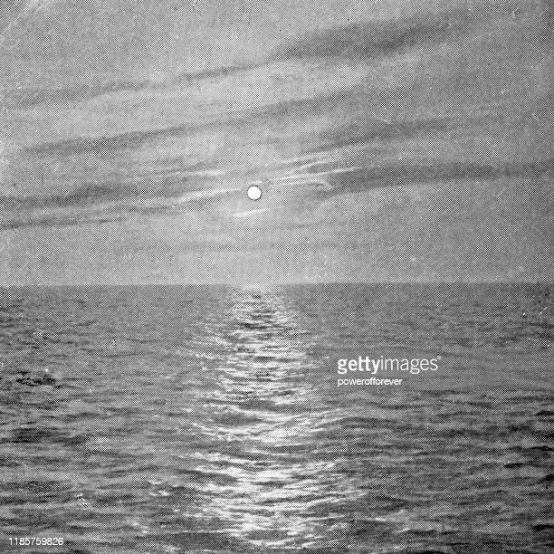 midnight sun over the barents sea in finnmark, norway - 19th century - etching stock illustrations