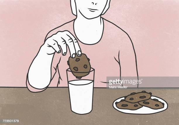 midsection of woman dunking cookie in milk at table against colored background - dipping stock illustrations, clip art, cartoons, & icons
