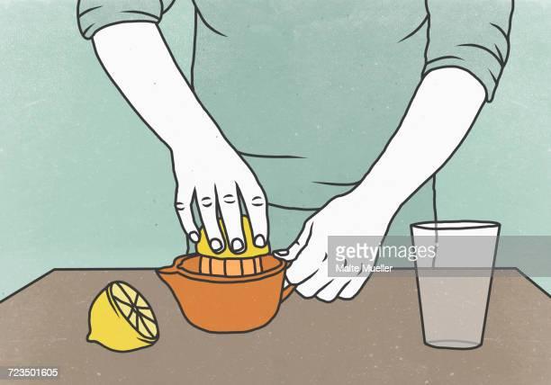 ilustrações, clipart, desenhos animados e ícones de midsection of woman squeezing lemon on juicer against colored background - limão amarelo