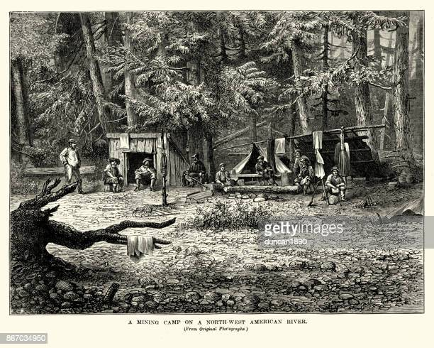 mining camp on a north-west american river, 19th century - gold rush stock illustrations