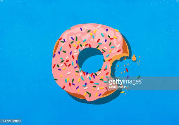 missing bite from donut with sprinkles - food and drink stock illustrations