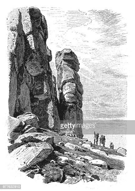 mittagstein ,12-meter high sunflower , as the literal translation into german , rock formation made of granite in the eastern part of the silesian ridge of the giant mountains in poland - granite rock stock illustrations, clip art, cartoons, & icons