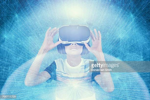 mixed race boy wearing vr goggles in cyberspace - teenager stock illustrations