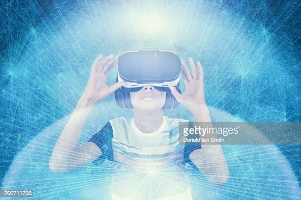 ilustraciones, imágenes clip art, dibujos animados e iconos de stock de mixed race boy wearing vr goggles in cyberspace - adolescente