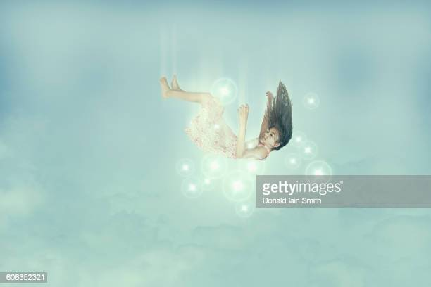 mixed race girl falling in sky - ethereal stock illustrations, clip art, cartoons, & icons