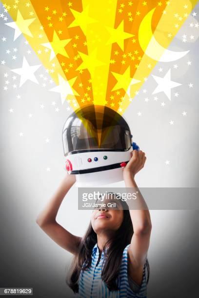 ilustrações de stock, clip art, desenhos animados e ícones de mixed race girl imagining being an astronaut - cabelo liso