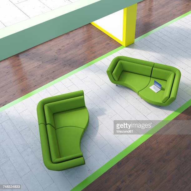 Modern waiting area with laptop on couch