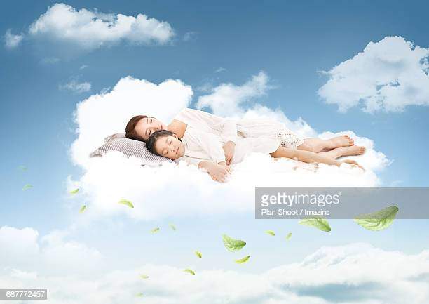Mom and daughter sleeping on cloud