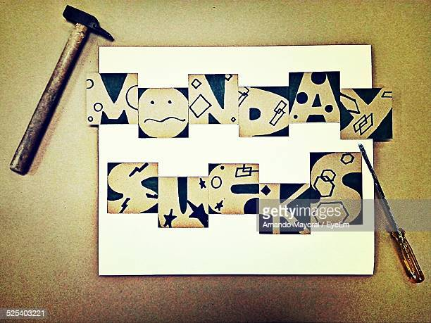 monday sucks on placard with hammer and screwdriver - capital letter stock illustrations
