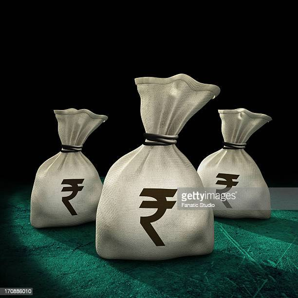 ilustraciones, imágenes clip art, dibujos animados e iconos de stock de money sacks with rupee symbol over black background - capitalismo