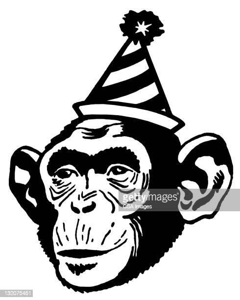monkey wearing party hat - chimpanzee stock illustrations, clip art, cartoons, & icons