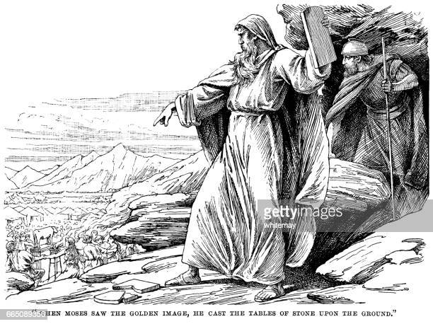 Moses casting the tablets of stone on the ground
