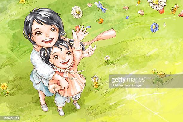 Mother and daughter having fun in grassland