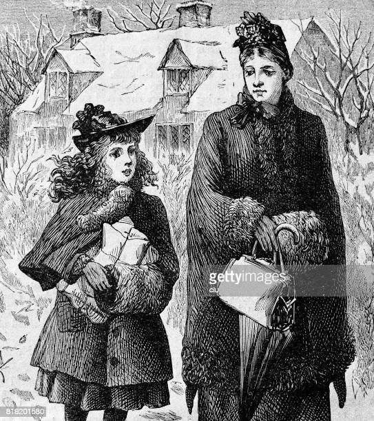 Mother and daugther walking home with  christmas gifts