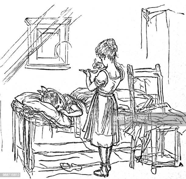 母はまた病気の娘、ベッドで横になっている薬を与える