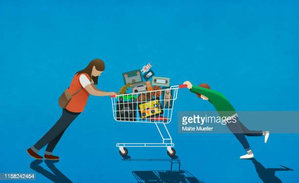 mother resisting son pushing shopping cart full of toys - consumerism stock illustrations