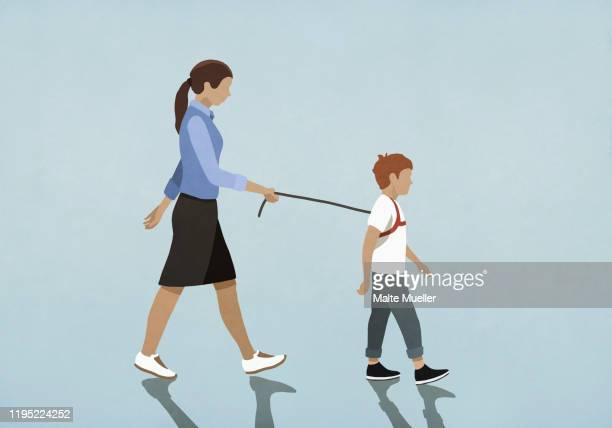 mother walking son with harness - family stock illustrations