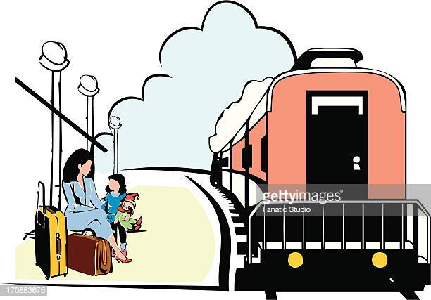 Mother with her daughter waiting for a train on a platform