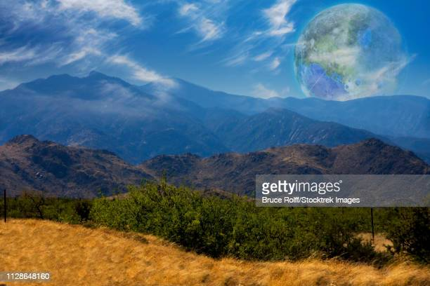 Mountain Vista. Terraformed moon seen from the Earth. 3D rendering