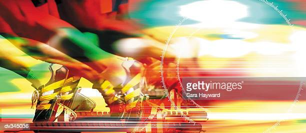 Multicolored composite of runner's feet at starting block