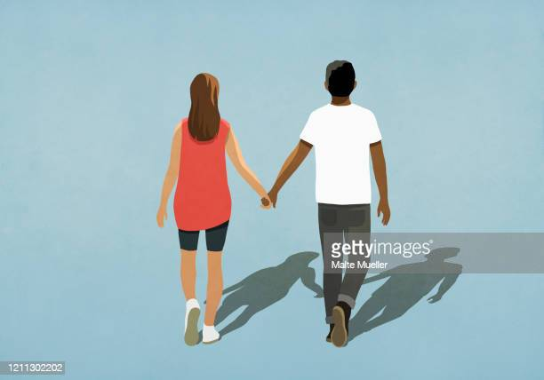 multiethnic couple holding hands and walking - {{ contactusnotification.cta }} stock illustrations