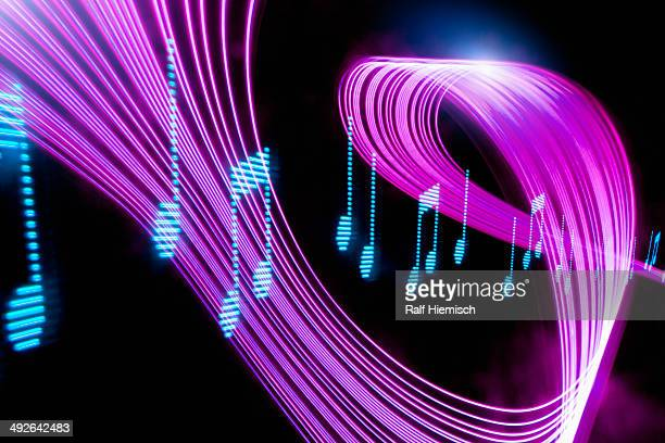 musical notes with psychedelic lights - musical note stock illustrations
