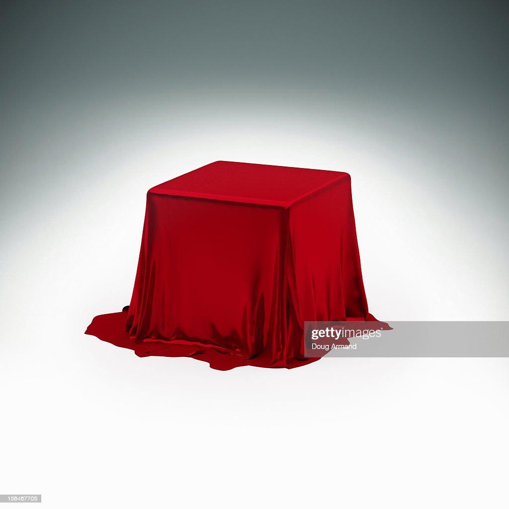 Mystery box under red silk cloth : ストックイラストレーション