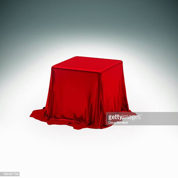 Mystery box under red silk cloth