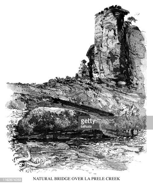 natural bridge over la prele creek - natural arch stock illustrations, clip art, cartoons, & icons