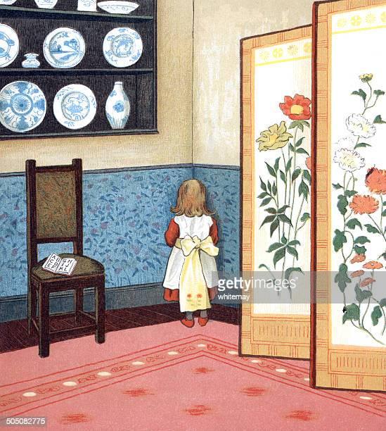 Naughty little girl standing in the corner