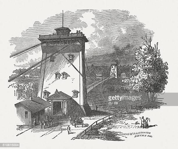 niagara falls upper suspension bridge (1867-1889), wood engraving, published 1880 - 1880 1889 stock illustrations