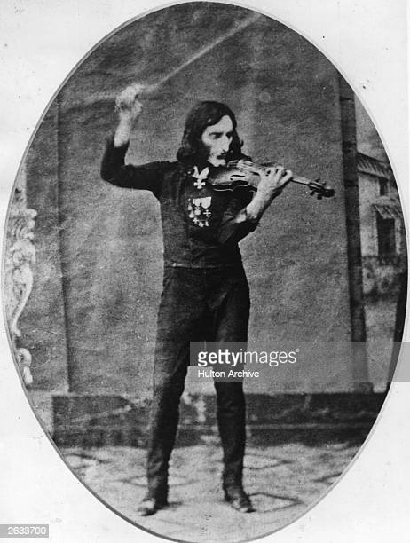 Niccolo Paganini Italian violin virtuoso who revolutionized violin technique and published several concertos seen here playing the violin shortly...