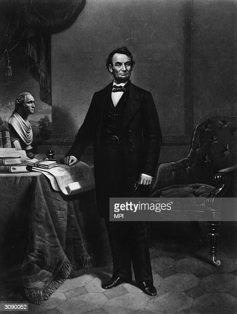 Abraham Lincoln the Sixteenth President of the United States of America standing with his hand resting on a copy of a Gettysburg Address