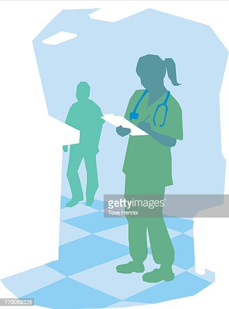 A nurse writing notes on a clipboard