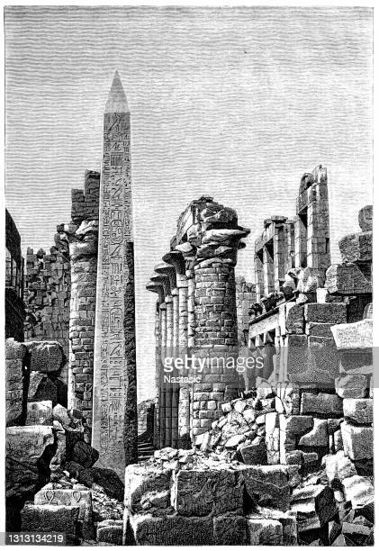 obelisk of tutmosis i in a part of the front column hall of the temple of karnak, luxor, upper egypt - archaeology stock illustrations