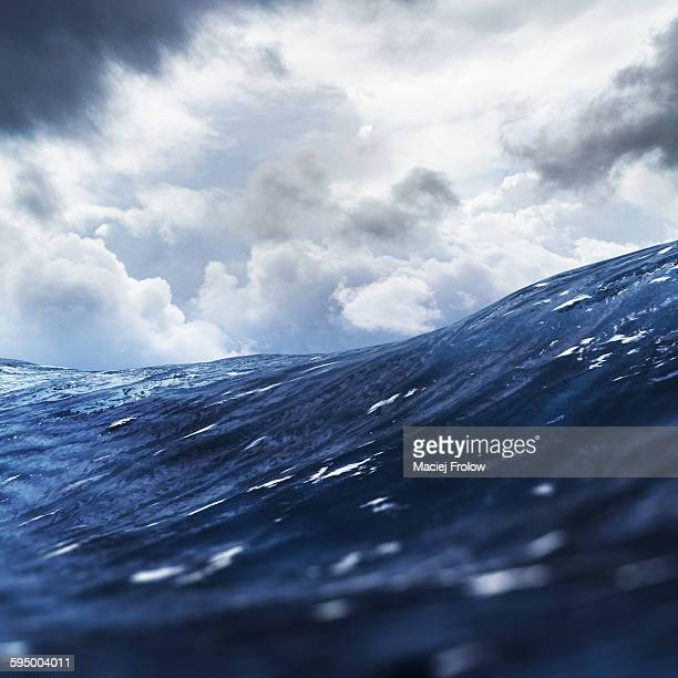 ocean waves and clouds - dramatic sky stock illustrations