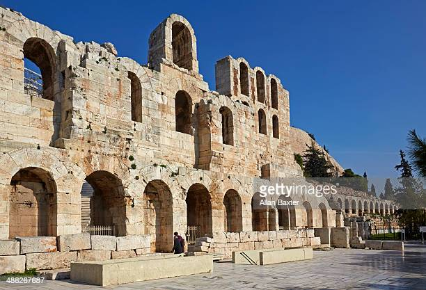 odeon of herodes atticus at the acropolis - ancient greece stock illustrations