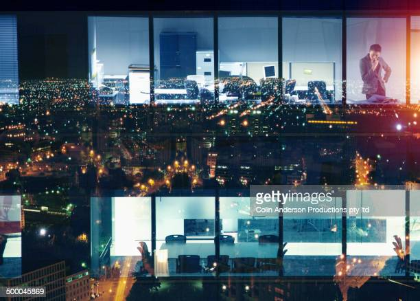 Office building over reflection of cityscape