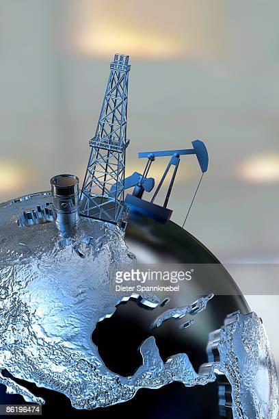 oil barrel and pump on a globe