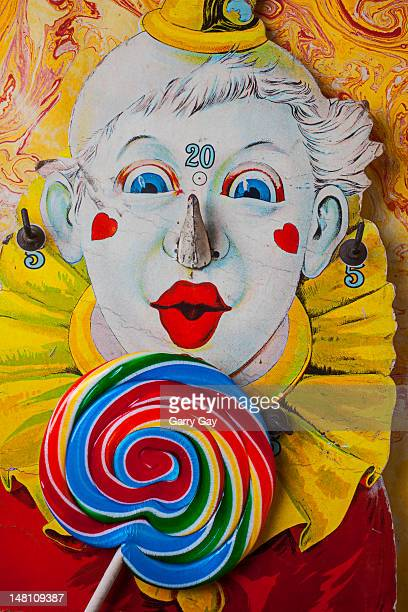 Old clown game and candy sucker