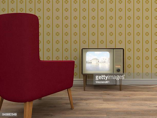 Old television and red armchair in a retro styled living room