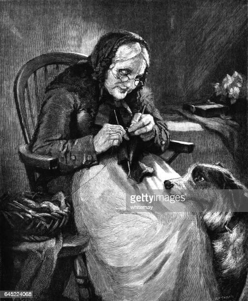 Mujer haciendo punto mientras su perro le