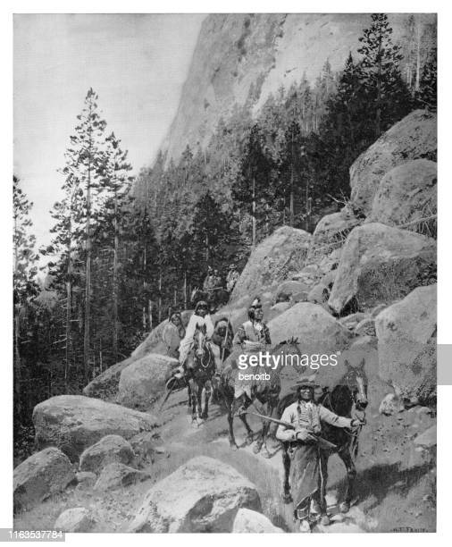 on the mountain trail - 19th century stock illustrations