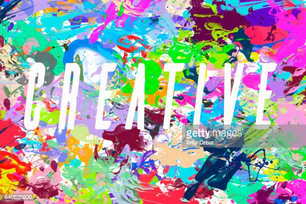 Original illustration made with splash of different colors like a canvas with the creative words on it with white color.
