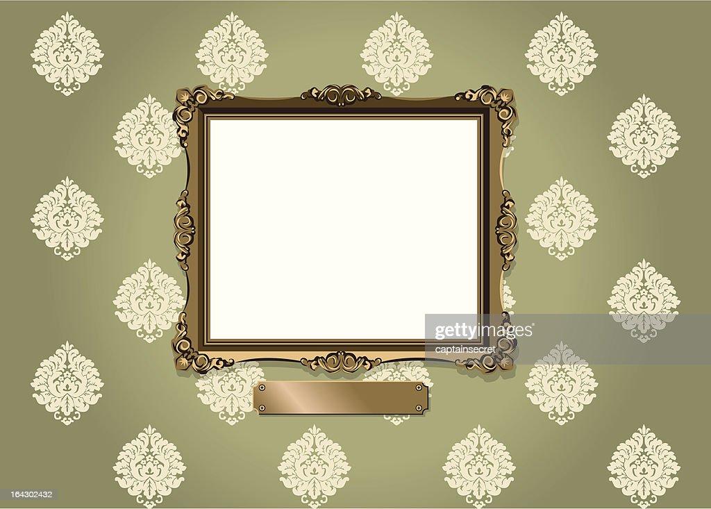 Ornate frame and plaque against vintage wallpaper