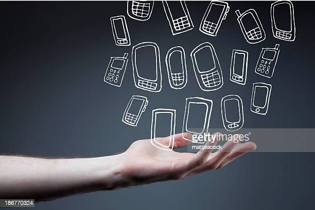 outstretched arm with smart phones