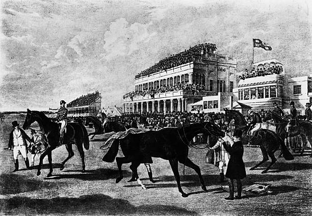 Owners and jockeys with their horses in front of the...